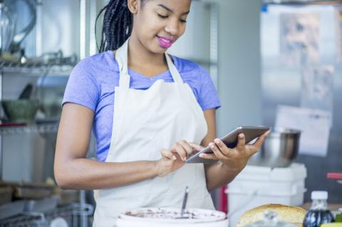 Food employee looking at digital device